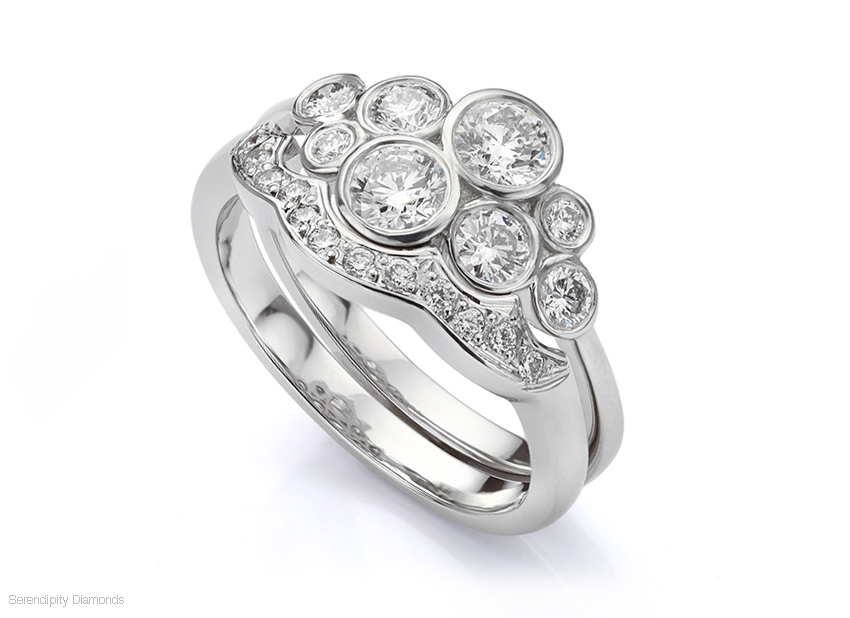 Shaped wedding ring fitting to a diamond bubble ring