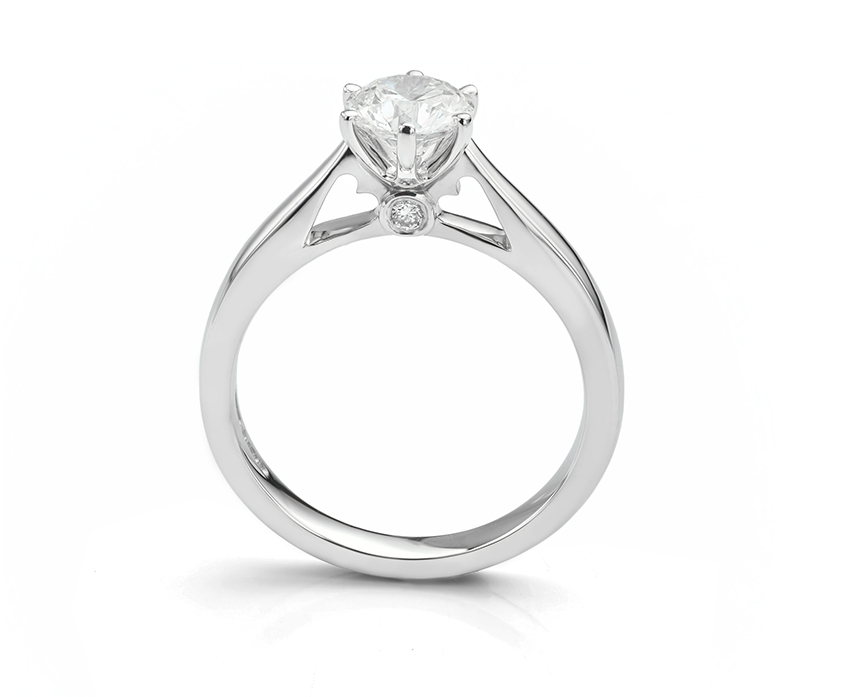 Solitaire engagement ring with heart shaped shoulders