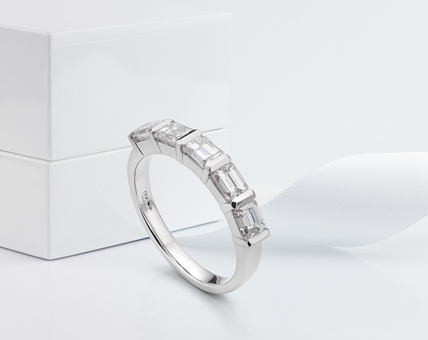 Upgraded from 18ct White Gold to Platinum setting for an Emerald cut diamond eternity ring