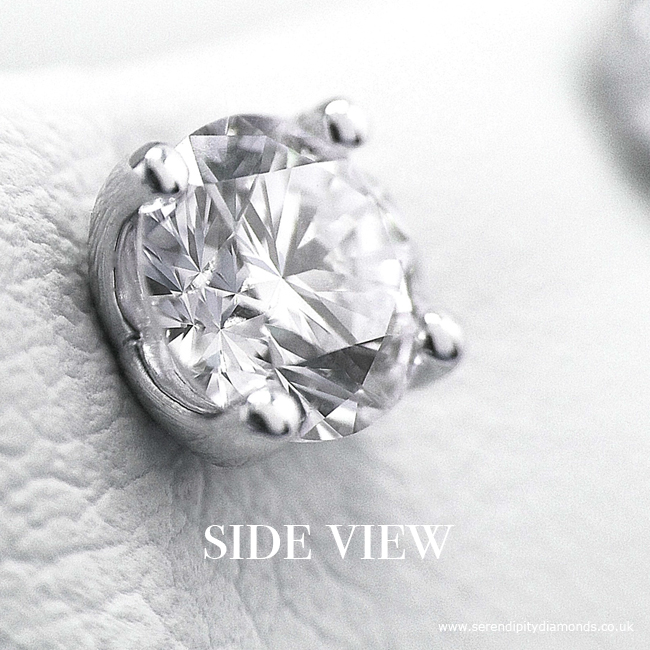 Side view of four claw diamond earring, showing simple open setting style.