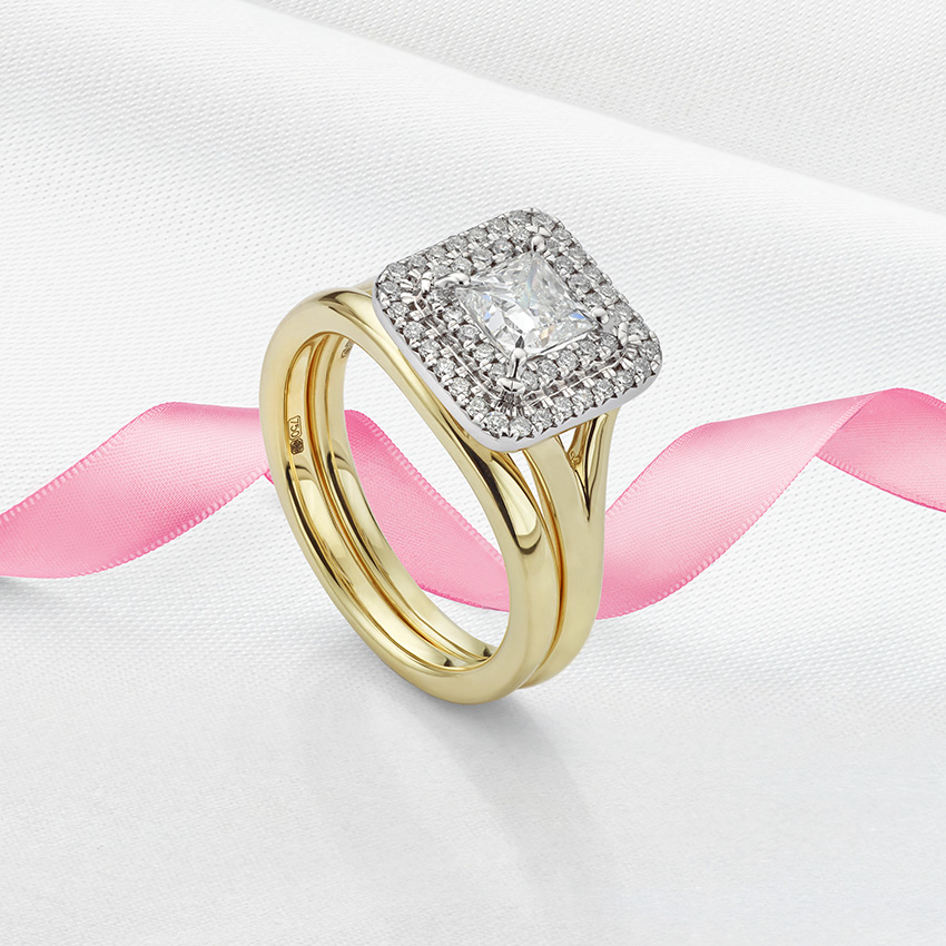 Double halo ring with forked shoulders