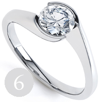 Cross over diamond engagement ring with modern part bezel setting