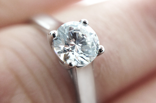 0.70 Carat diamond shown within four claw solitaire ring R1D059
