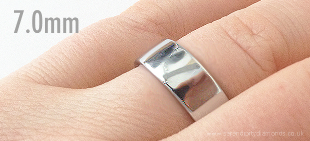 7mm wide mens wedding ring shown on the finger