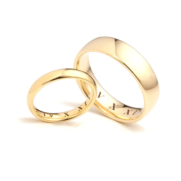 Roman numeral rings engraved in yellow gold
