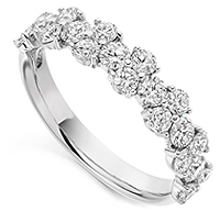 Fancy diamond cluster half eternity ring claw set with 1.20cts of round diamonds