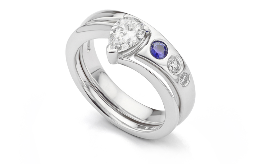 Flush set diamonds and sapphire in shaped wedding ring
