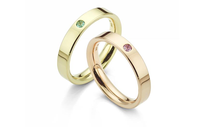 Flush set gemstone wedding rings