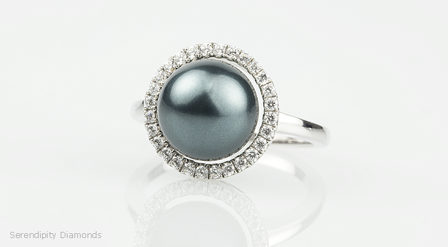 Black pearl and diamond rings featuring Tahitian pearl with halo of diamonds