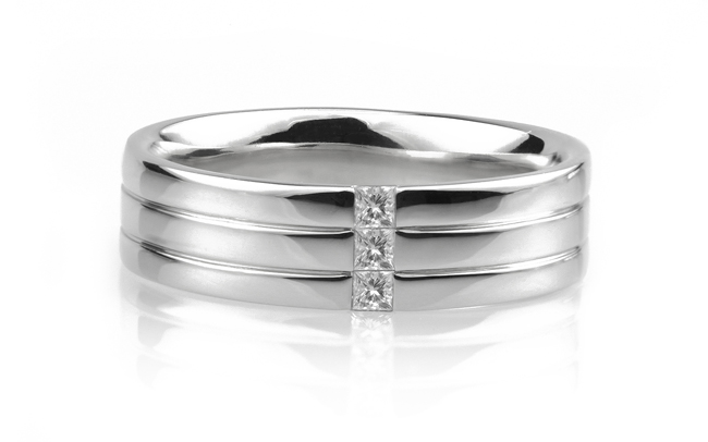 One of our wedding rings for men, combining a banded pattern with Princess cut diamonds