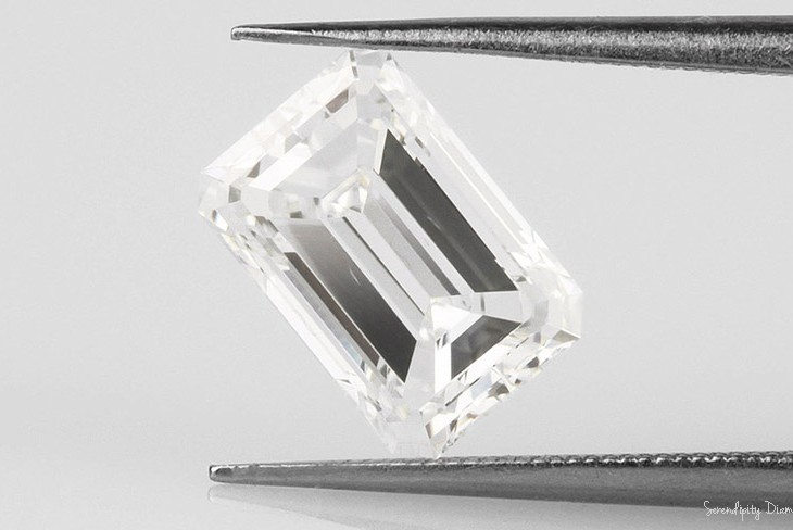 Feather shown within a large Emerald cut diamond.