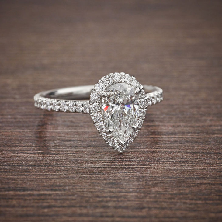 Popular pear shaped engagement ring with halo setting