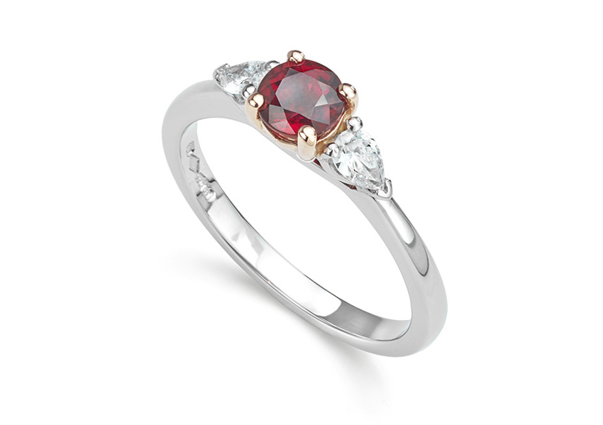 Ruby engagement ring with diamond shoulders
