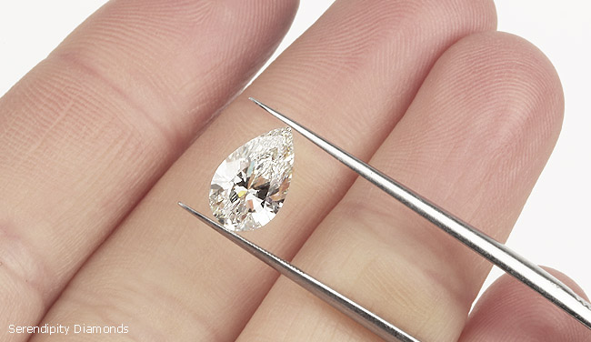 Round cut engagement ring on finger