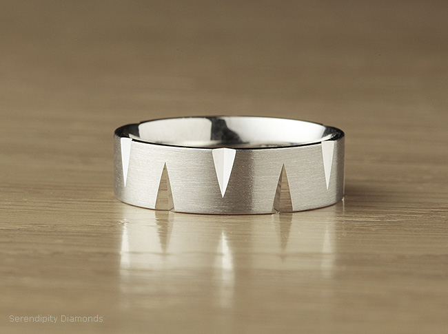 A brushed finish, satin wedding ring applied to a flat court profile band with additional cut pattern.