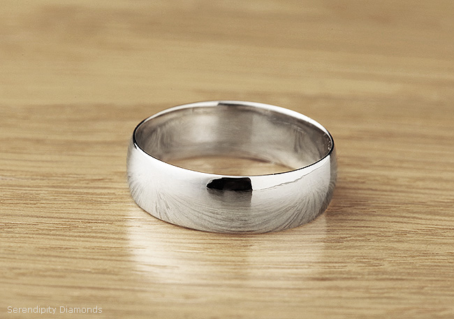 The finished penny wedding ring, polished and sized.