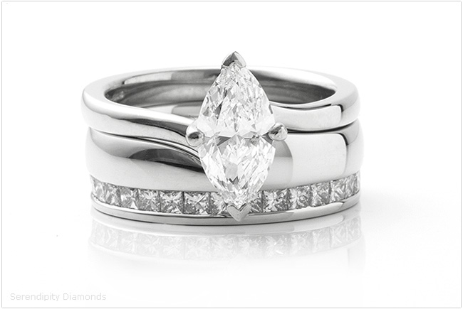 Showing both rings as they fit together - engagement ring with twist setting and contoured shaped diamond eternity ring