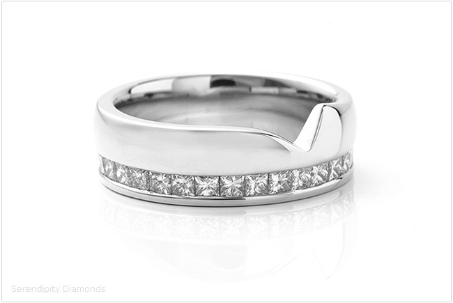 A photograph of the eternity ring, clearly showing the shaped edge of the ring design.