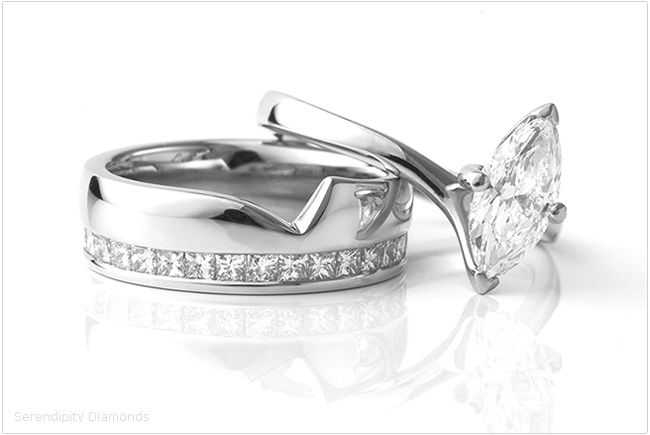 Shaped eternity rings, with channel set diamonds alongside the twist engagement ring.