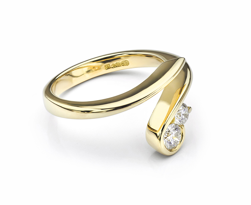 Flow 2 stone diamond engagement ring shown in ethical Fairtrade Gold