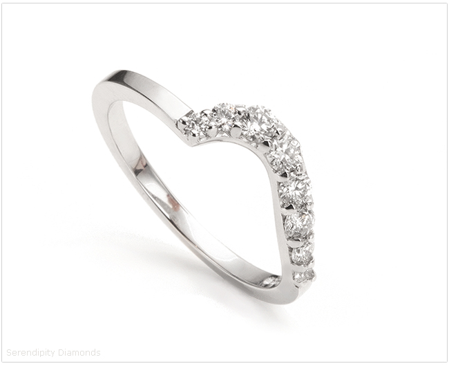 Graduated diamond shaped wedding ring, claws set with increasing sizes of diamond