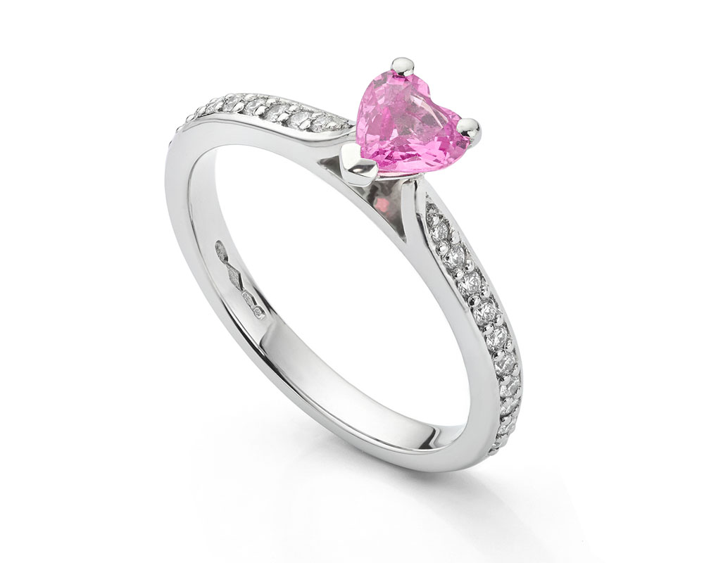 Pink sapphire heart shaped engagement ring with diamond shoulders