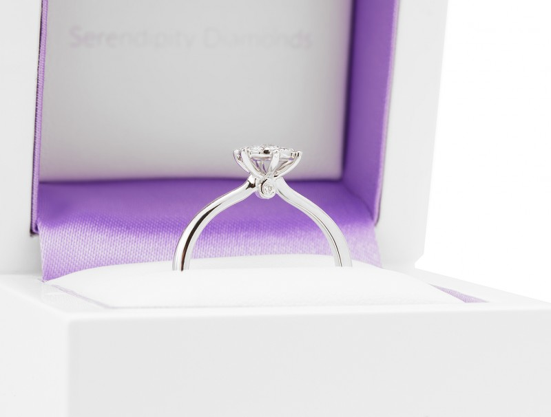 Side view of the solitaire effect diamond cluster engagement ring