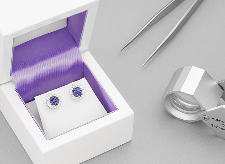Blue sapphire and diamond halo earrings