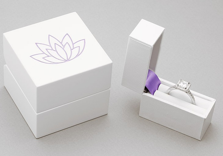 Small engagement ring box for pocket and main ring box shown