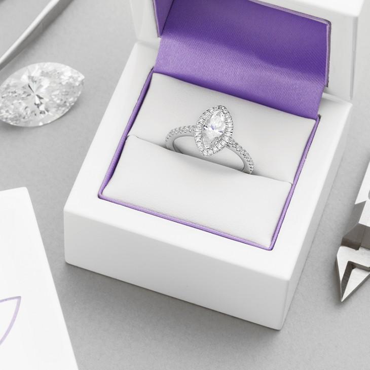 Marquise diamond halo engagement rings