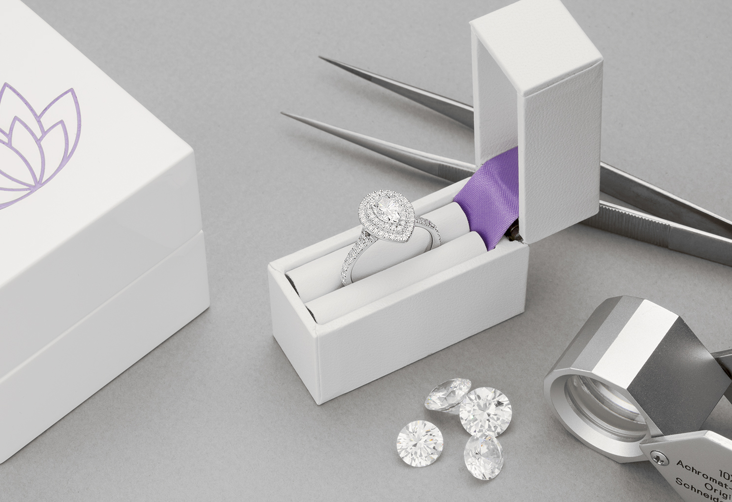 Double halo engagement ring in pocket box
