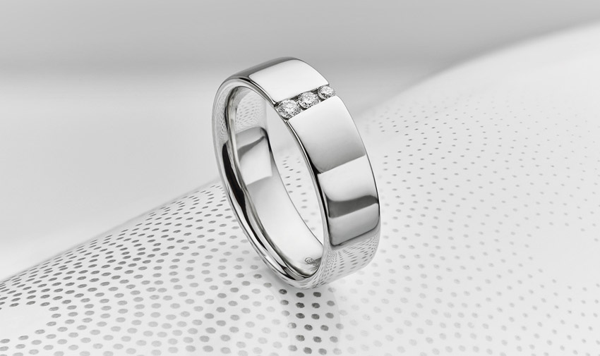 Men's wedding ring channel set with graduated diamonds
