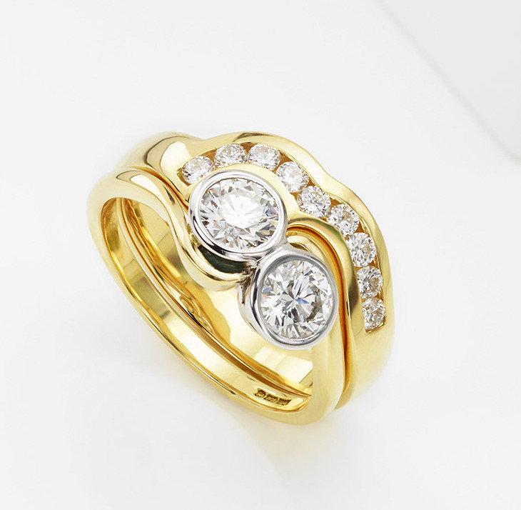 Shaped wedding ring with channel set diamonds