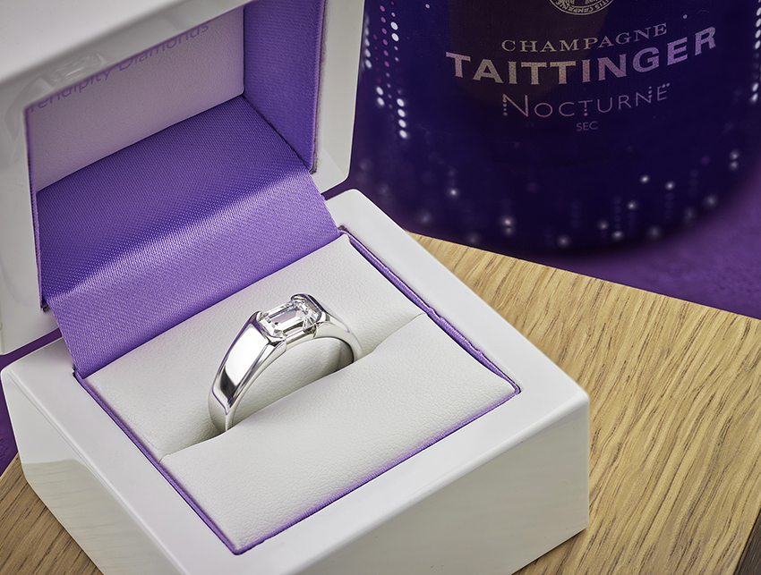 mens engagement ring in platinum, set with a 1 carat emerald cut diamond