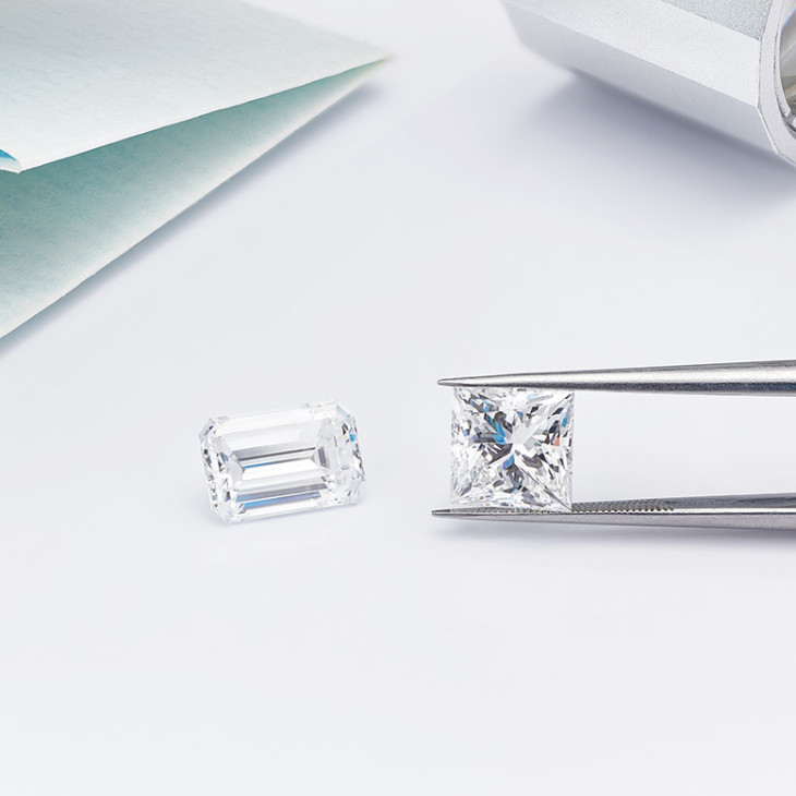 2 carat emerald cut and 2 carat princess cut photographed alongside each other