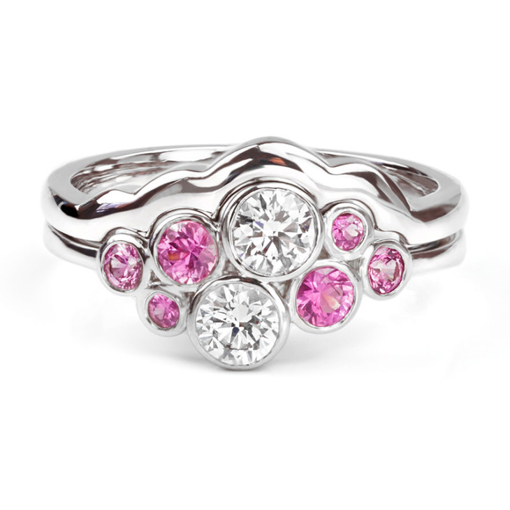 Pink sapphire and diamond bubble ring with shaped wedding ring