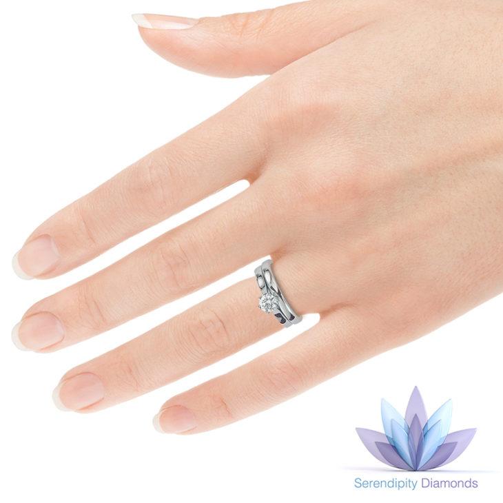 Ballerina solitaire engagement ring on finger