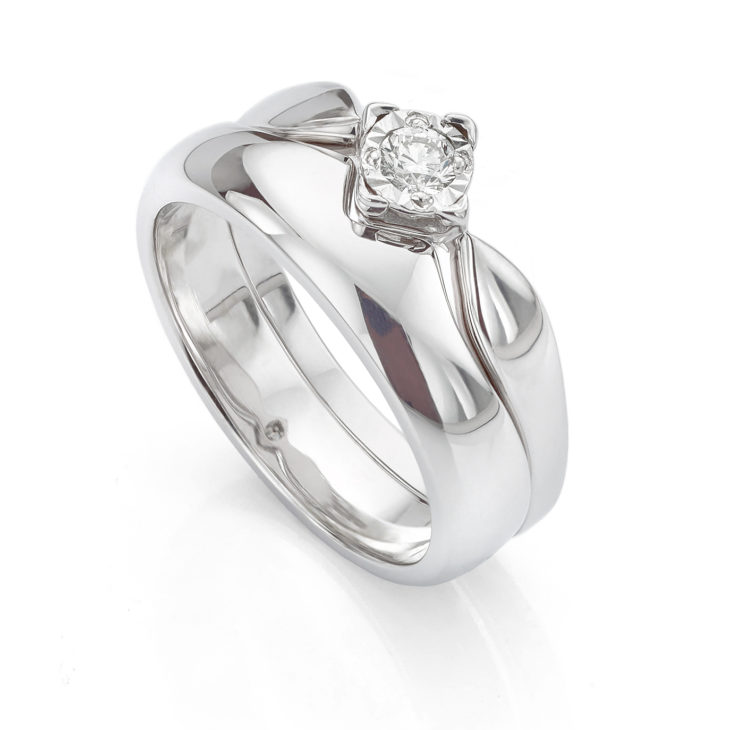 Cut out wedding ring to fit engagement ring