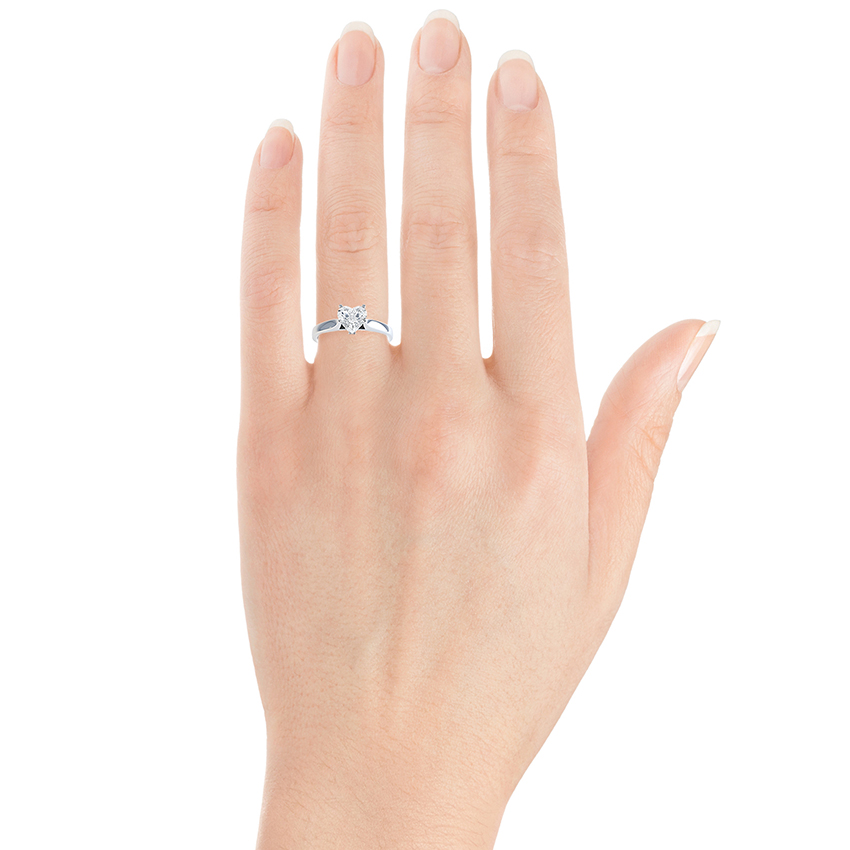 Heart shaped engagement ring shown on hand
