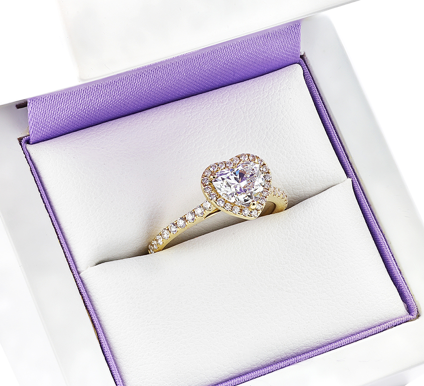Boxed heart-shaped diamond halo engagement ring