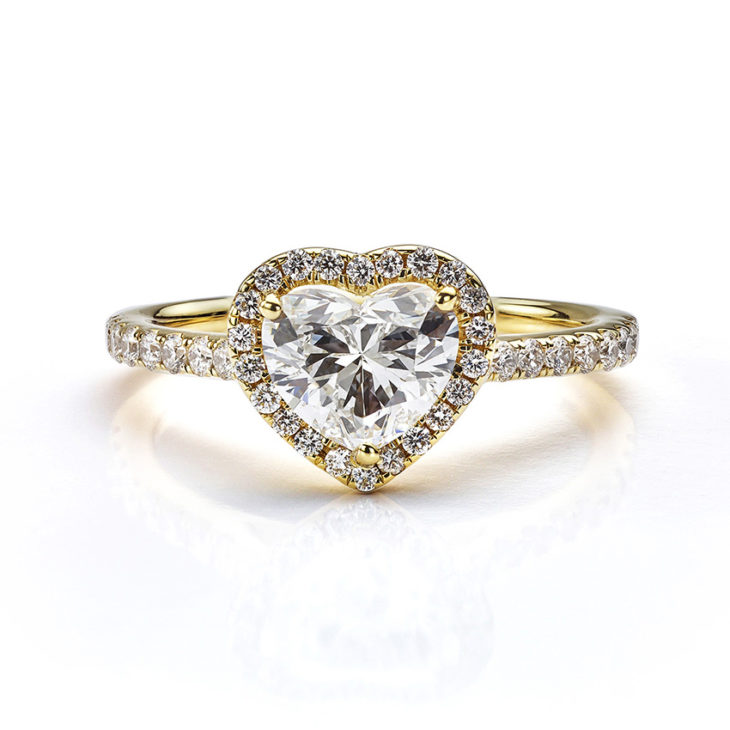 Heart-shaped diamond halo engagement ring in yellow gold