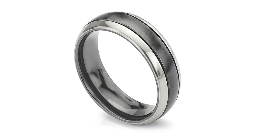 Magpie wedding ring is banded in black and silver colours