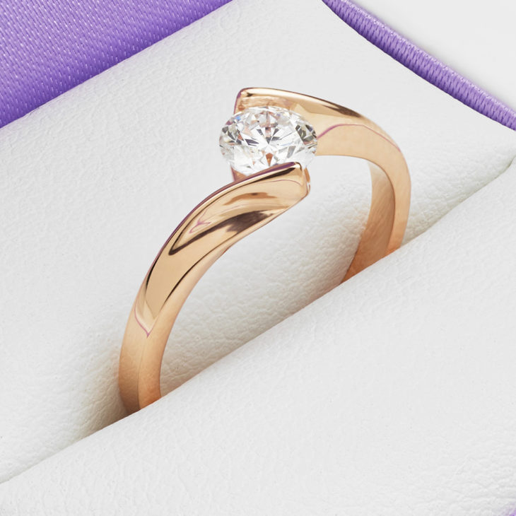The Unity engagement ring features a diamond that appears to float above the setting