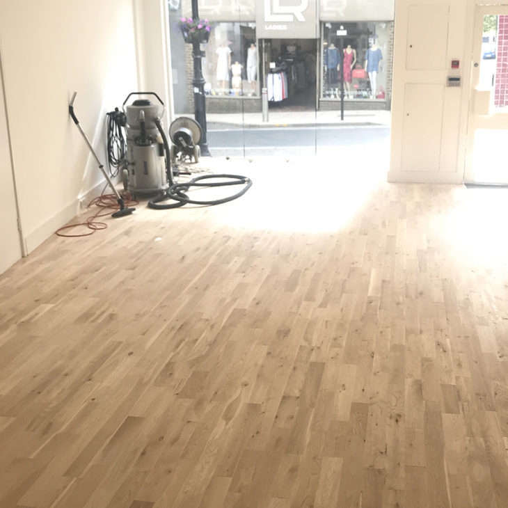 Renovating the oak floor at the Serendipity Diamonds shop