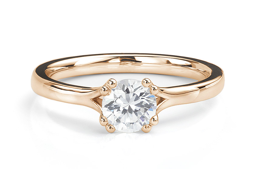 Renoir solitaire engagement ring made in Rose Gold
