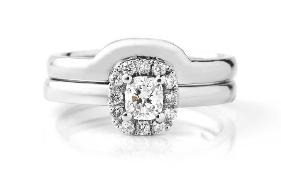 Cushion cut diamond engagement ring with a shaped wedding ring