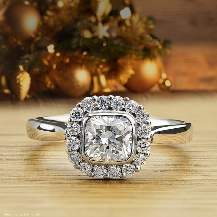 Antique style cushion cut diamond halo engagement ring