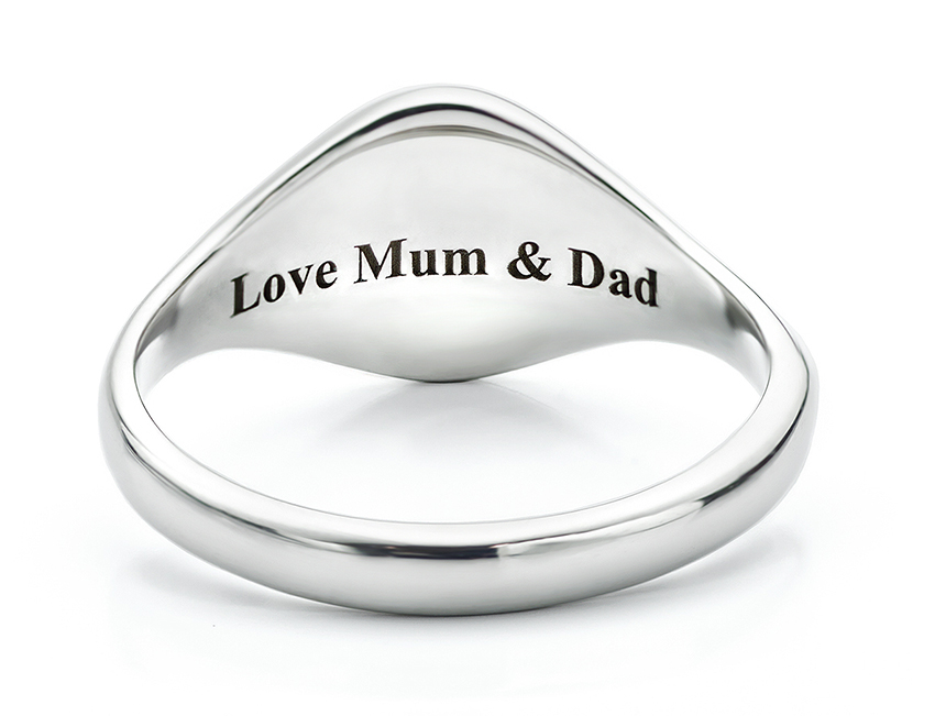 Personal message secret engraving on the underside of a small signet ring