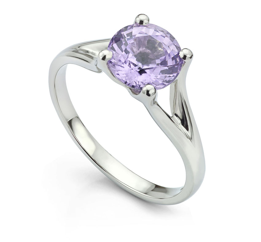 Unusual Spinel solitaire ring featuring double forked shoulders