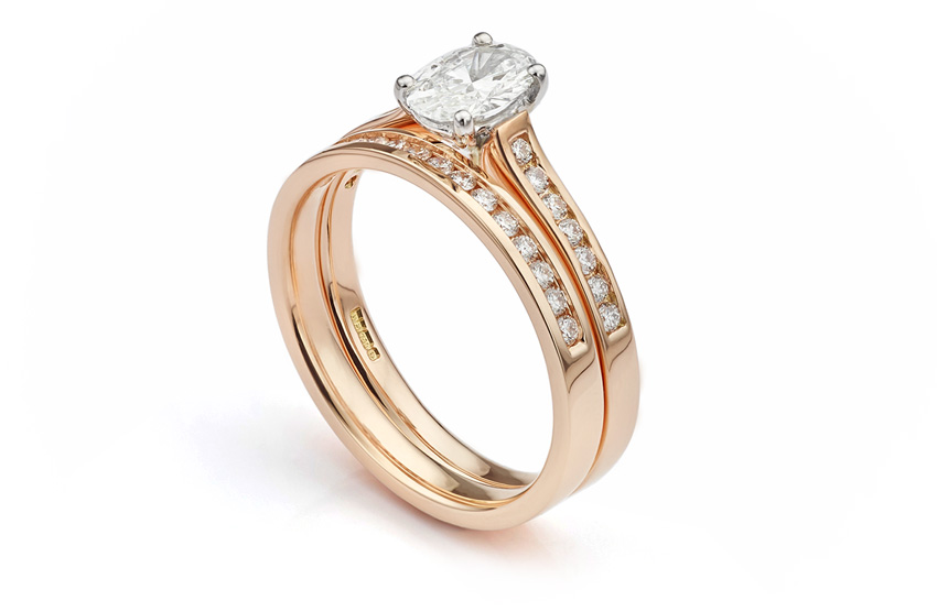 Half diamond eternity ring in rose gold set with Aprils birthstone